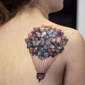Tatuagens Femininas nas costas balao de borboletas